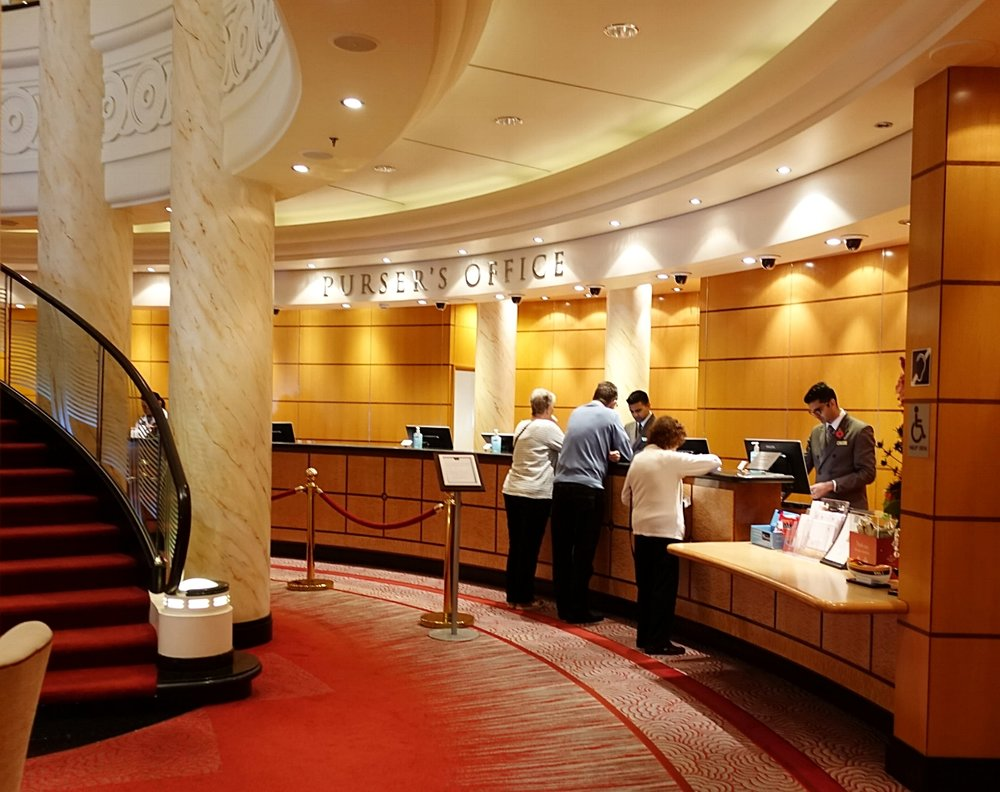 The Pursers desk located on deck 2 in the Grand Lobby.
