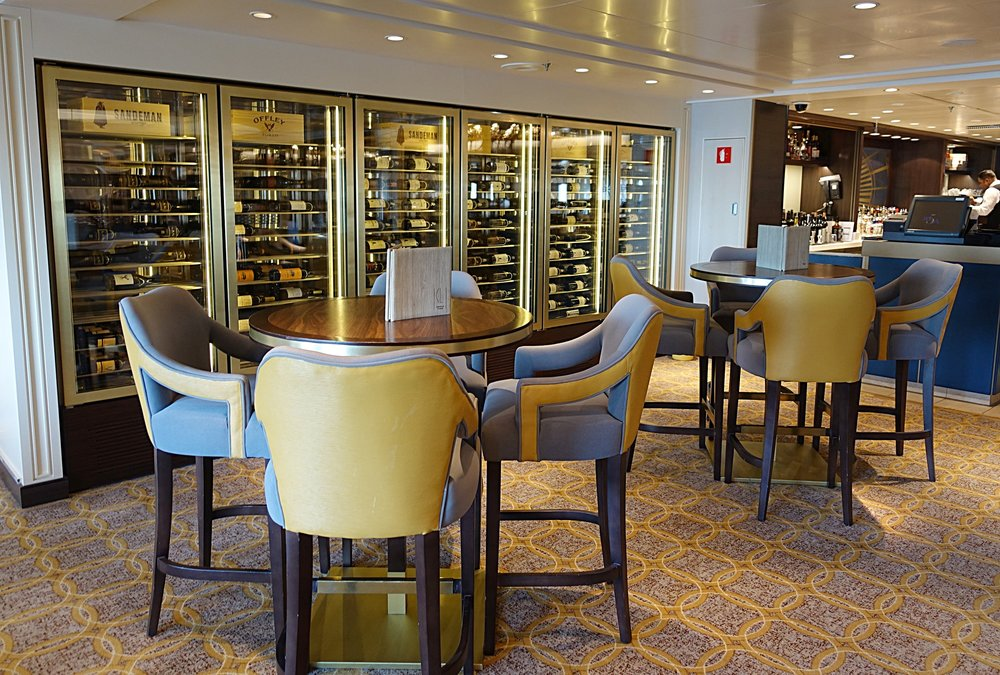 The wine stores and high chairs and stools in the bar area of the Carinthia Lounge.