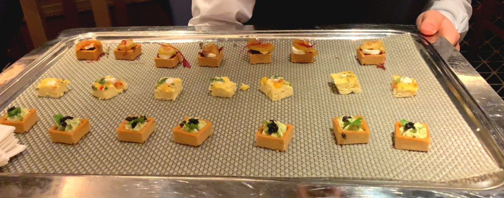 The ever changing tray of canapés.