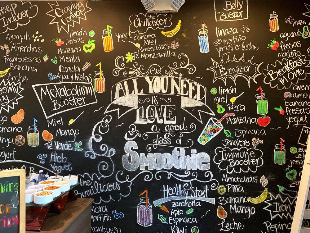 The smoothie bar menu wall.