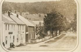 Depot Street, with covered bridge in the distance. Probably late 1800s.