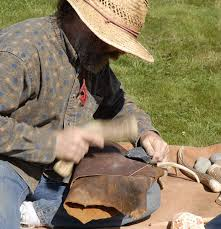 Charlie Paquin demonstrating the art of flint-knapping.