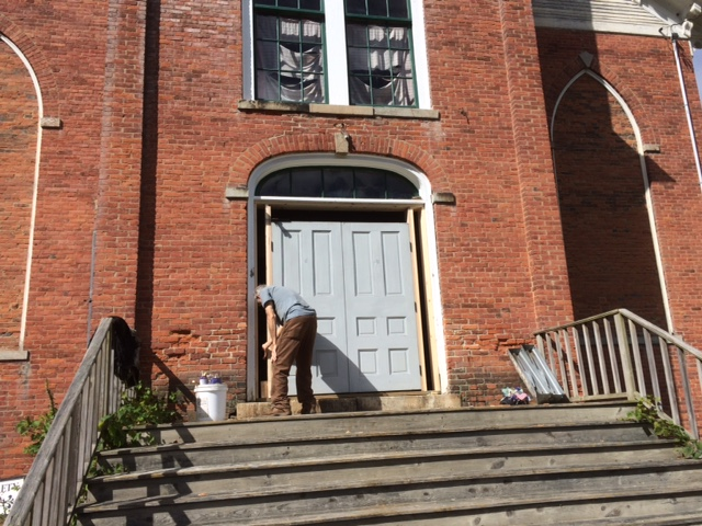 New doors being installed at the Cavendish Historical Society Museum.