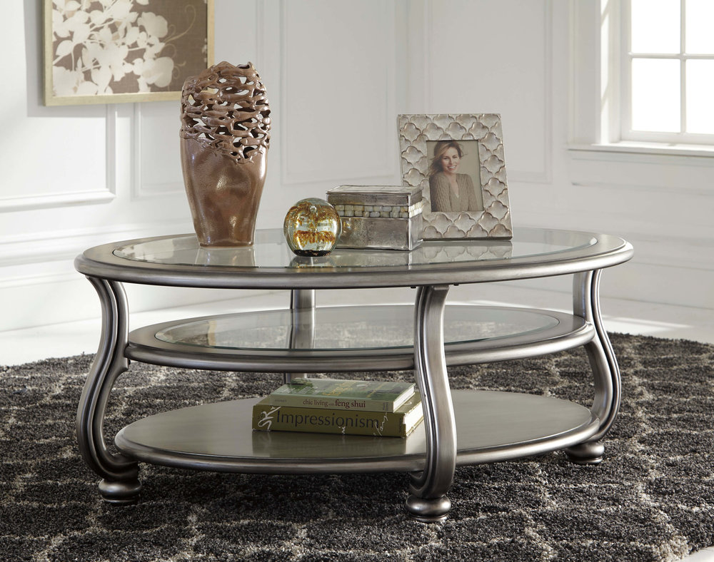 WAREHOUSE PRICE: $349.99 | MONTHLY PAYMENT $7 O.A.C COCKTAIL TABLE