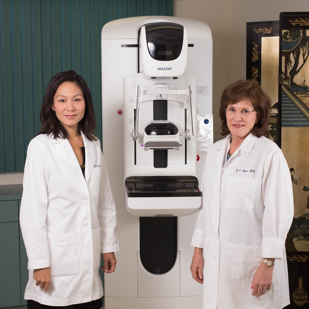 Dr. Judy Dean and Dr. Winnie Leung stand next to Pueblo Radiology's digital 3D mammography imaging unit.