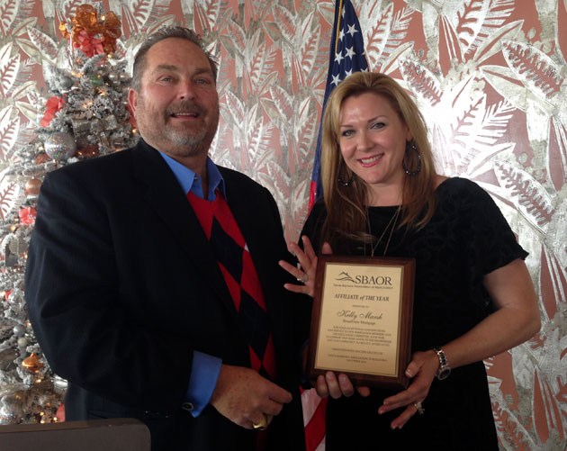 Kelly Marsh of Broadview Mortgage receives the Santa Barbara Association of Realtors' Affiliate of the Year Award for 2014 from John Chufar, broker associate at Sterling Properties. (Broadview Mortgage photo)