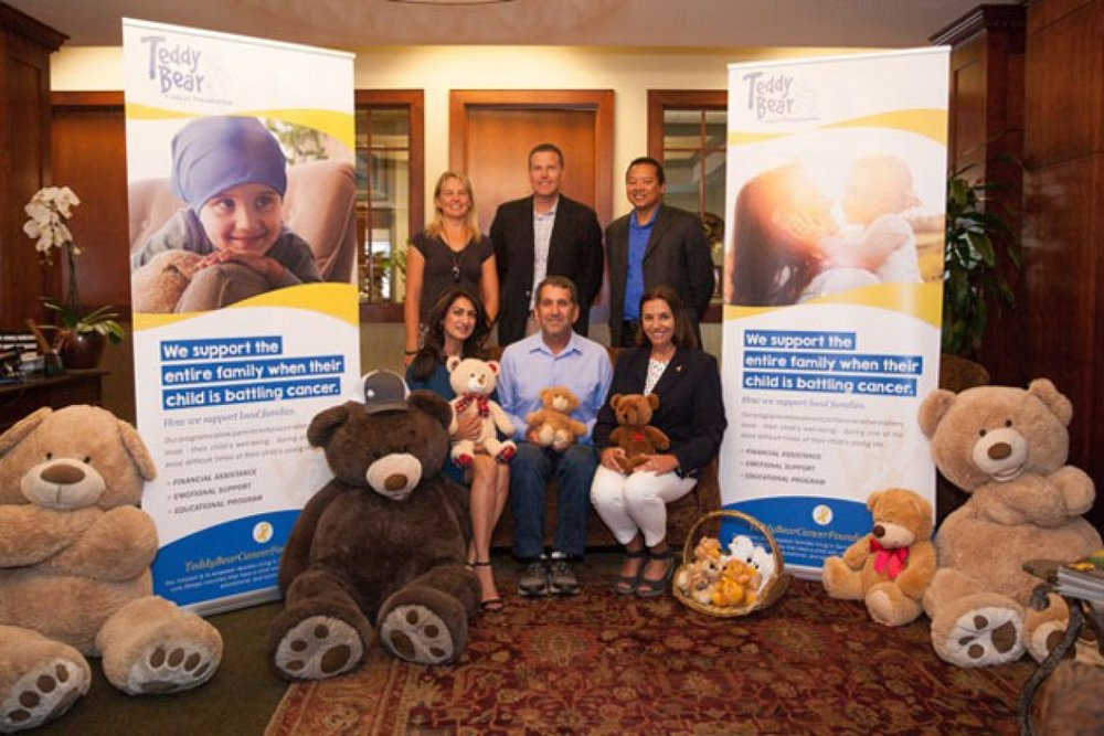 Helping to kick off off the teddy bear program are: Michelle Martinich, left, Rich Schuette, Robert Mislang, and seated, Sheela Hunt, left, Dave Edelman, Adriana Mezic. (American Riviera Bank)