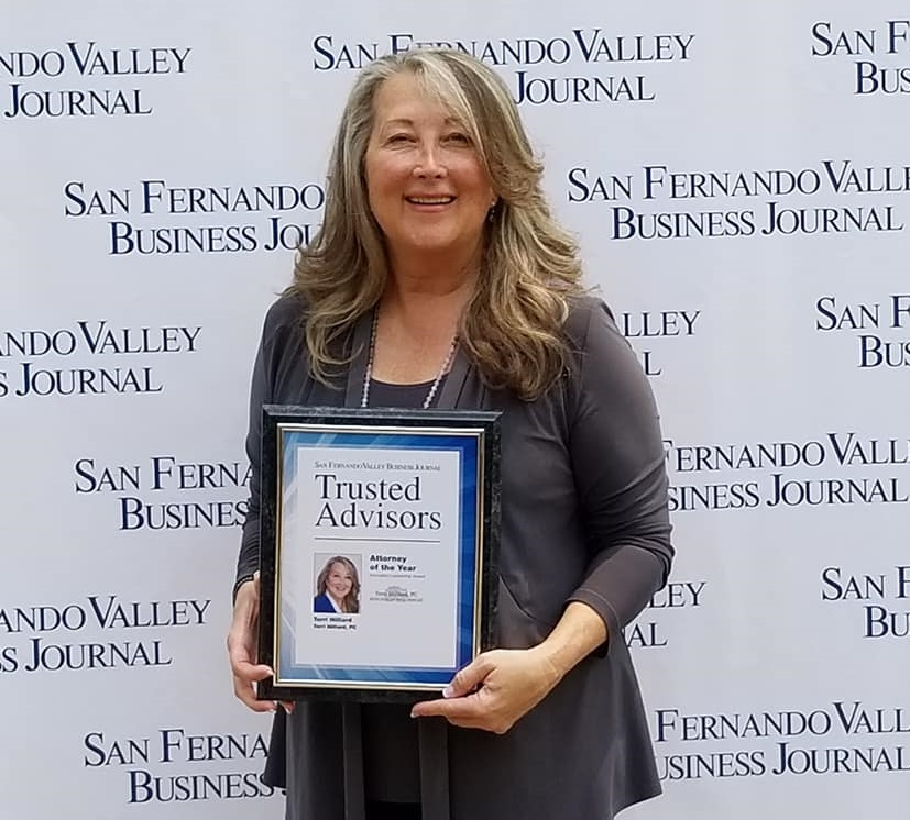 """Our client, Terri E. Hilliard Olson, Esq., nominated by The Goddard Company, walking the ""red carpet"" of the San Fernando Valley Business Journal after receiving the Trusted Advisors' Trailblazer Award last week. Two years in a row!"""