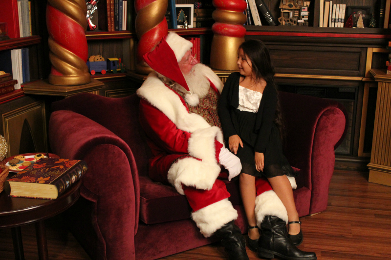 Sharing her with list with Santa Claus