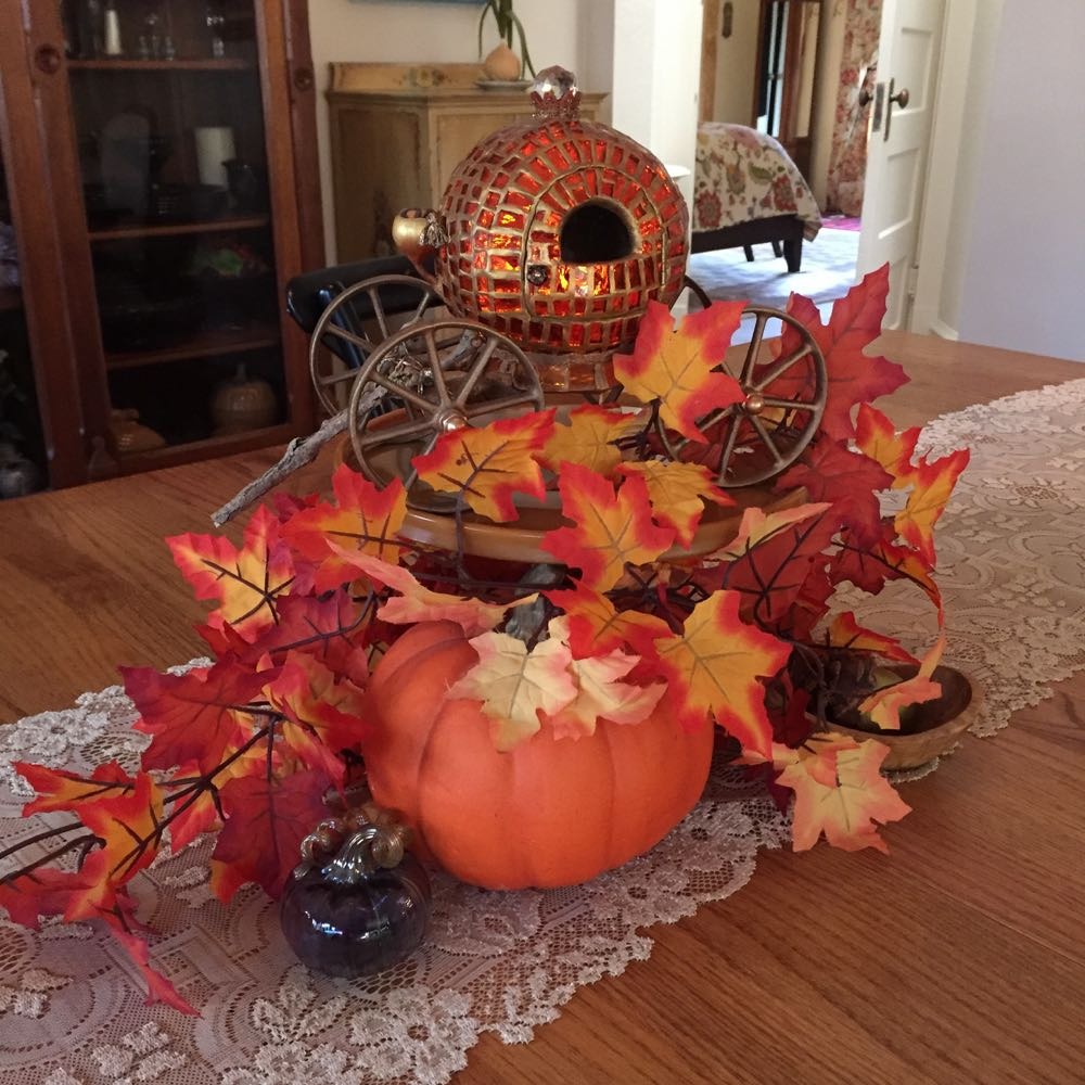 Cinderella's Pumpkin is en-route to Thanksgiving Dinner. Gourd covered in mosaic glass.