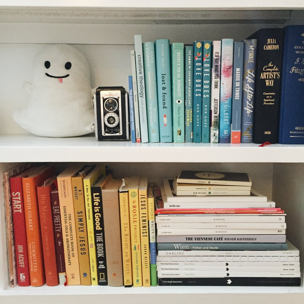 half of our cutie pie bookshelf. guess who the snapchat ghost plushy belongs to?