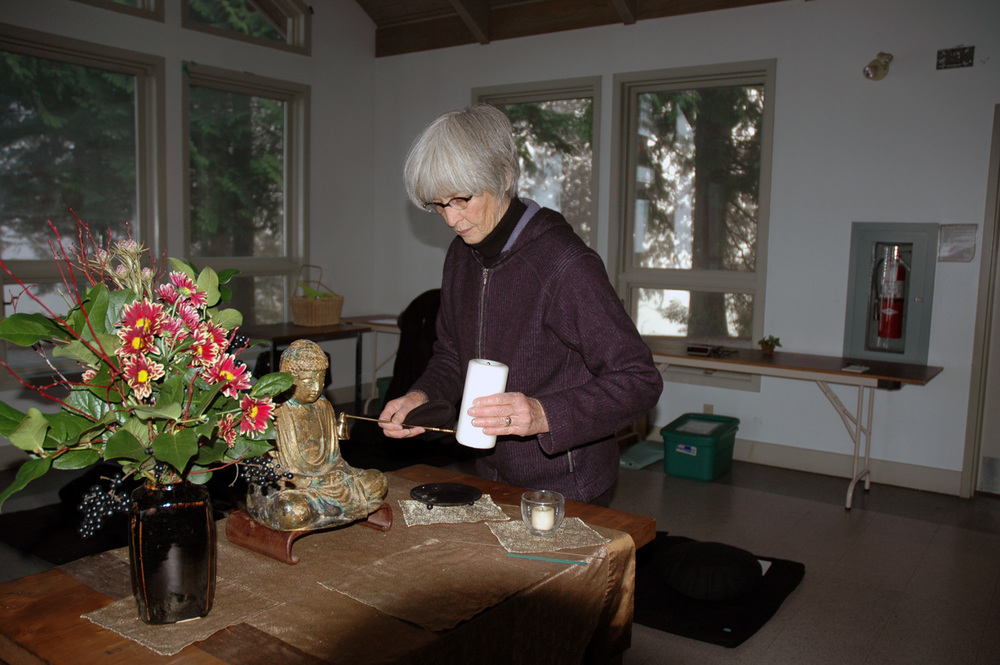 Cleaning the altar at Loon Lake Camp, work practice during an annual retreat