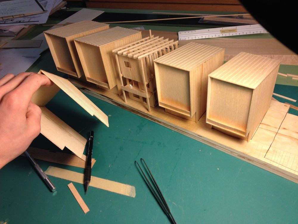 Building models: it's fun seeing your design come to life. Here is a series of massing models, with one articulated structural model in the middle.