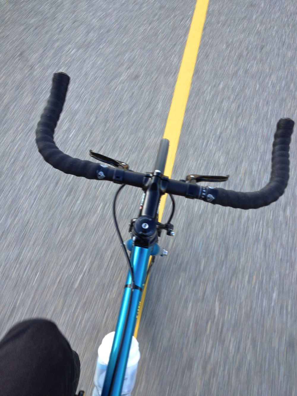 Riding my fixed gear bike along a designated bicycle path on the weekend.