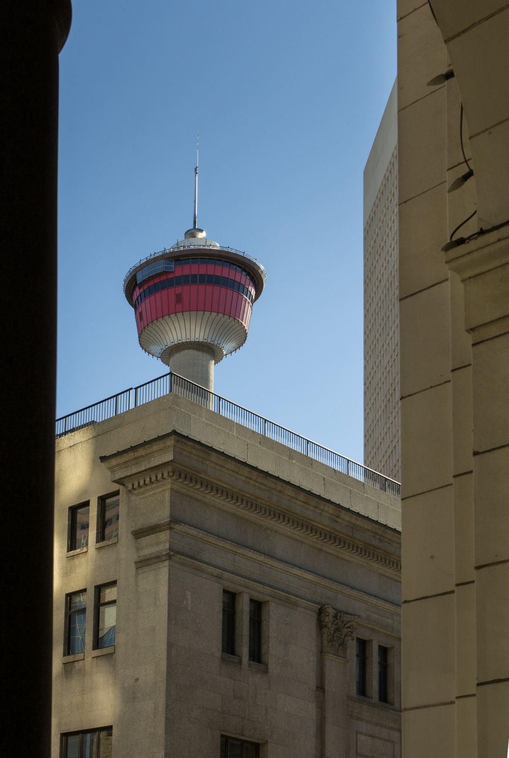 The Calgary Tower as seen through the arcade of a nearby building.