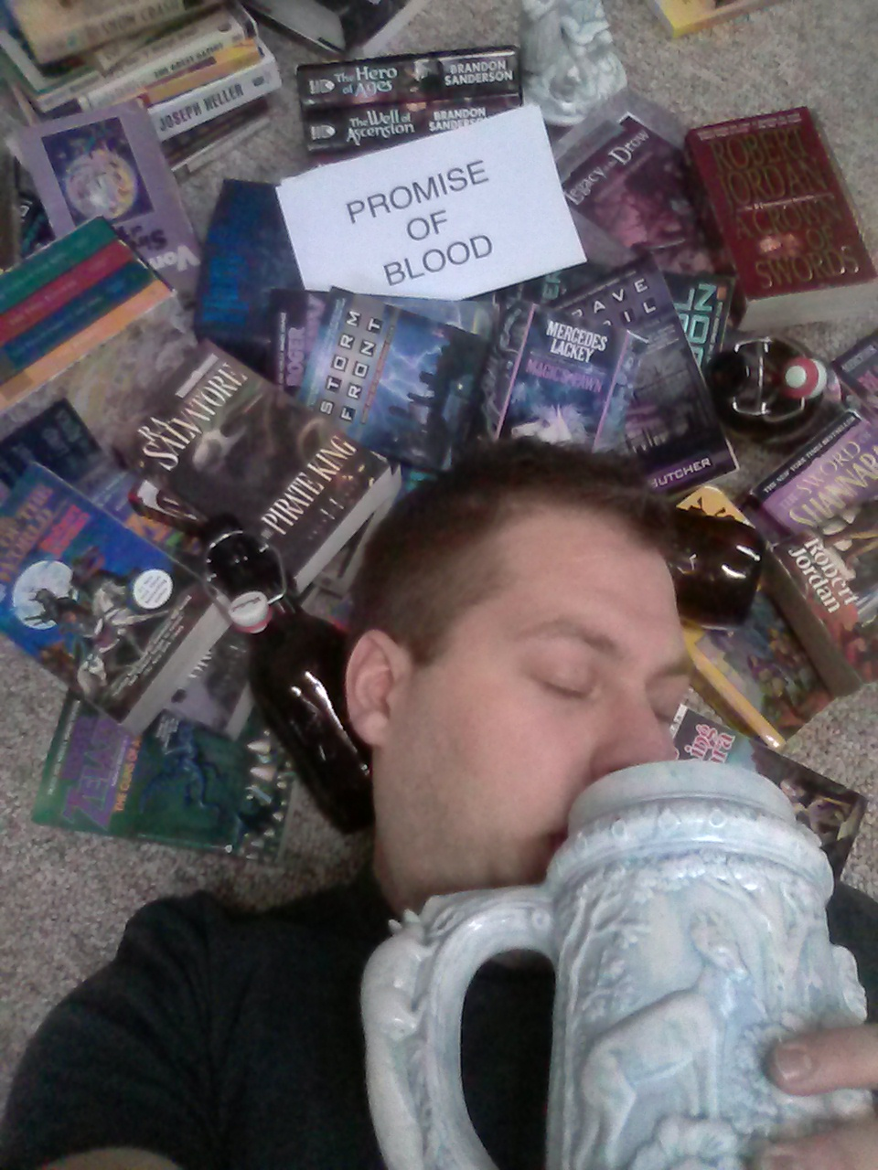 Miles, USA - He's so sad he doesn't have Promise of Blood that he's drunk himself into a book coma.