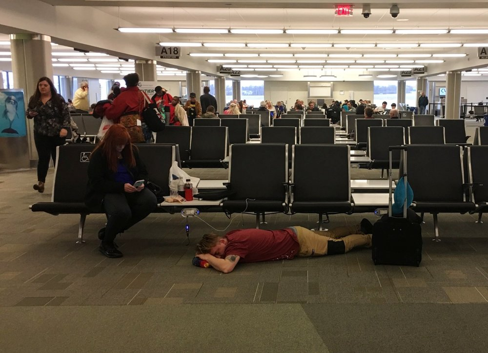 Catching some Z's on the airport floor