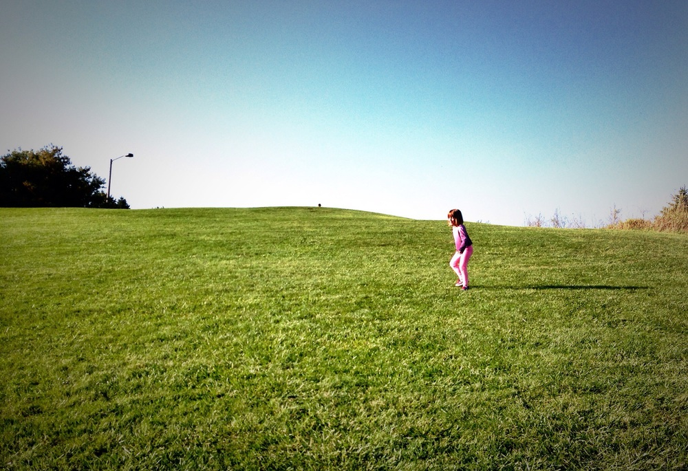 Ava enthusiastically running up the hill in Memorial Park.