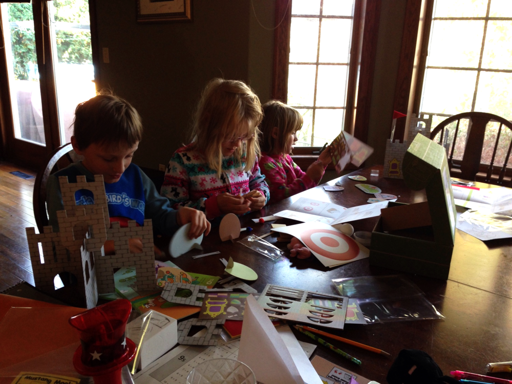 The kids crafting their latest Kiwi Crate. This months theme was adventure with castles and catapults.