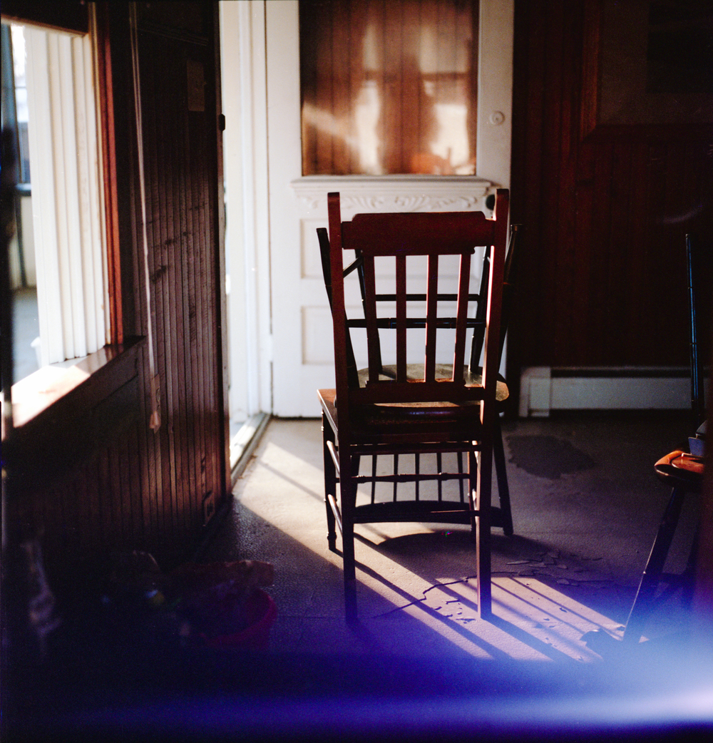 Stacked chairs with light leak