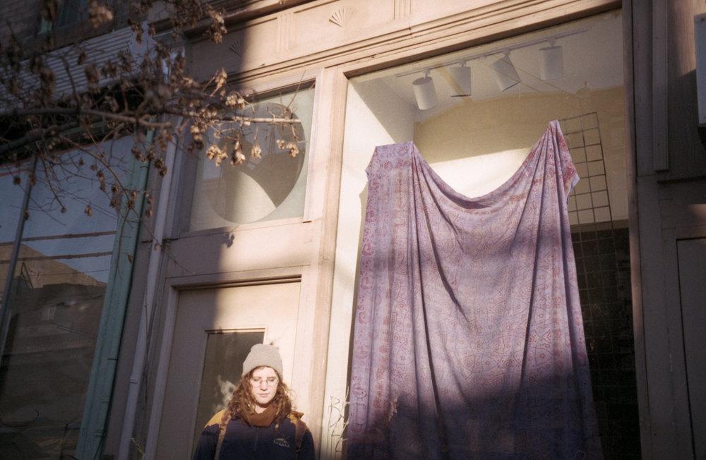 Kat and purple drapes