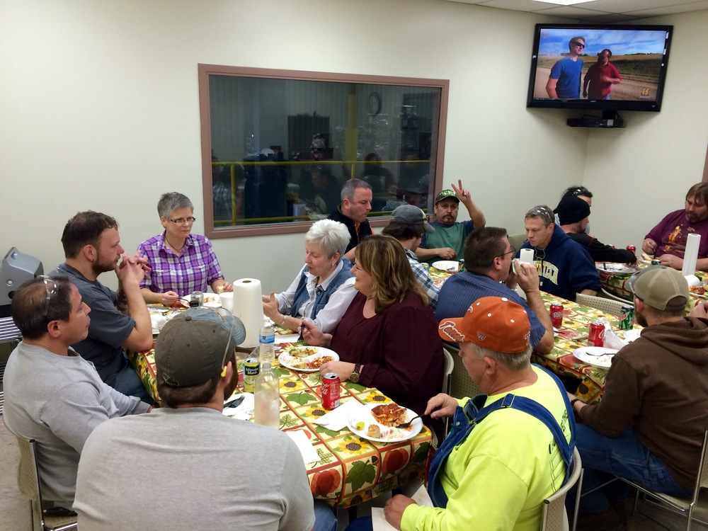 "Some of the day shift crew in Lebanon enjoying the ""traditional"" PFP Thanksgiving dinner of Lasagna, salad, bread and cheesecake (and an episode of American Pickers on the tube)!  Felix says ""Peace!"""