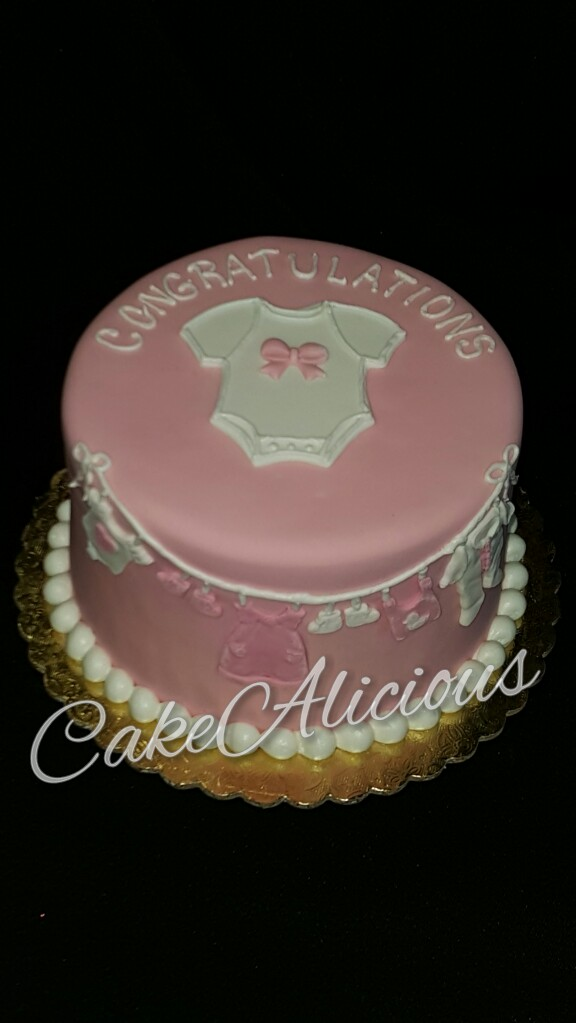 Pink  Fondant with Baby Clothes.JPG