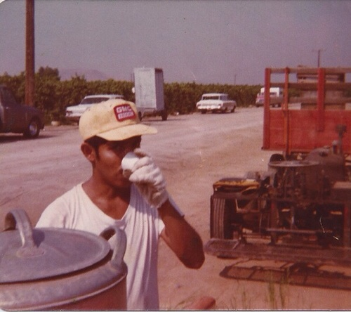 My father taking a break while working as a farm laborer in the mid-70's.
