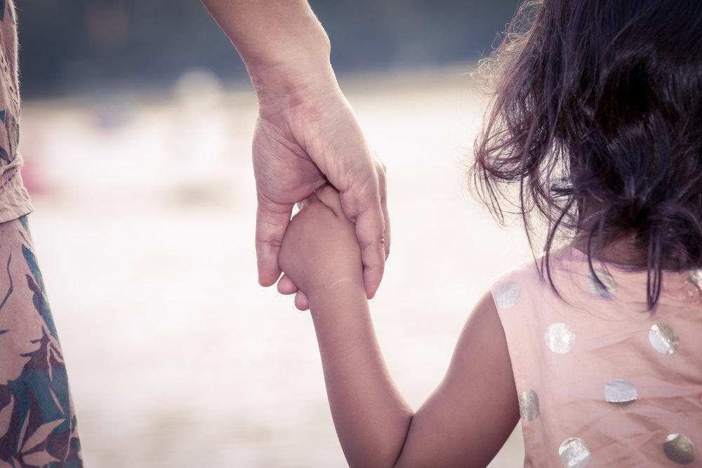 mother-child-holding-hands.jpg