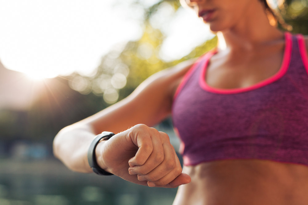 woman runner looking at watch