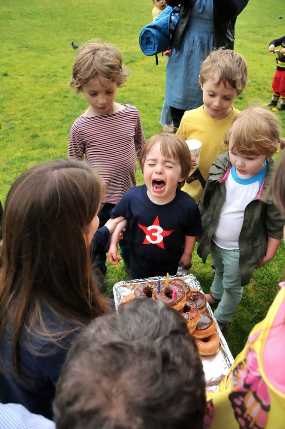 What's this kid's problem? I'd kill for a donut cake right now