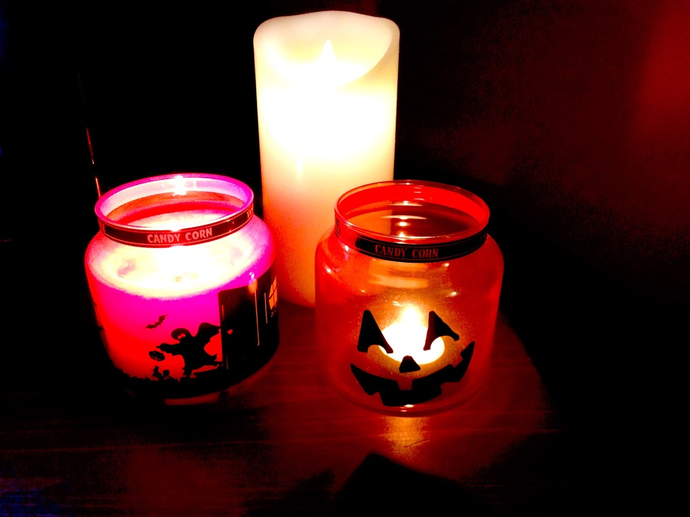Candles - Yankee candle candy corn, empty Yankee Halloween jar from last year and battery pillar candle.