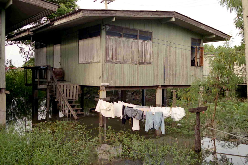 I lived in teacher housing while at Sa Klee school. This is my house during the annual floods — the infamous sewer pipe can be seen beneath the house behind the drying clothes. At this point the floods were still rather low. In the following weeks the floods would rise and overflow the dike protecting the school.