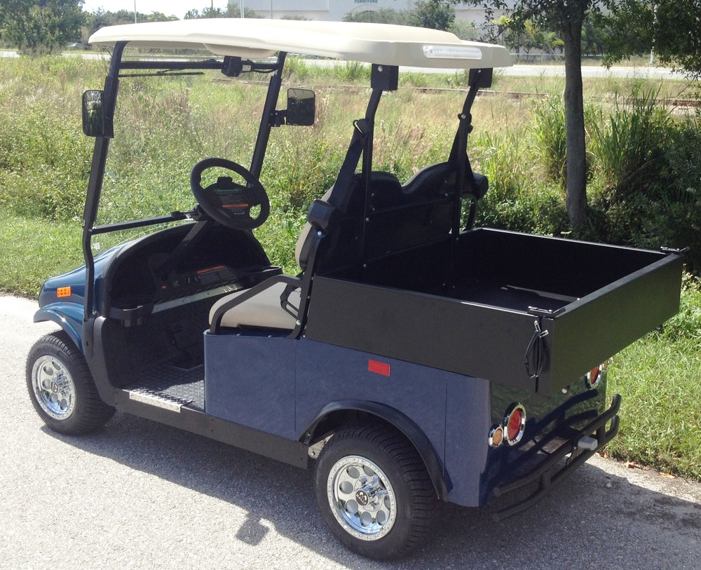 "Small two-passenger utility cart with a 36"" X 44"" X 10"" Cargo Bed."
