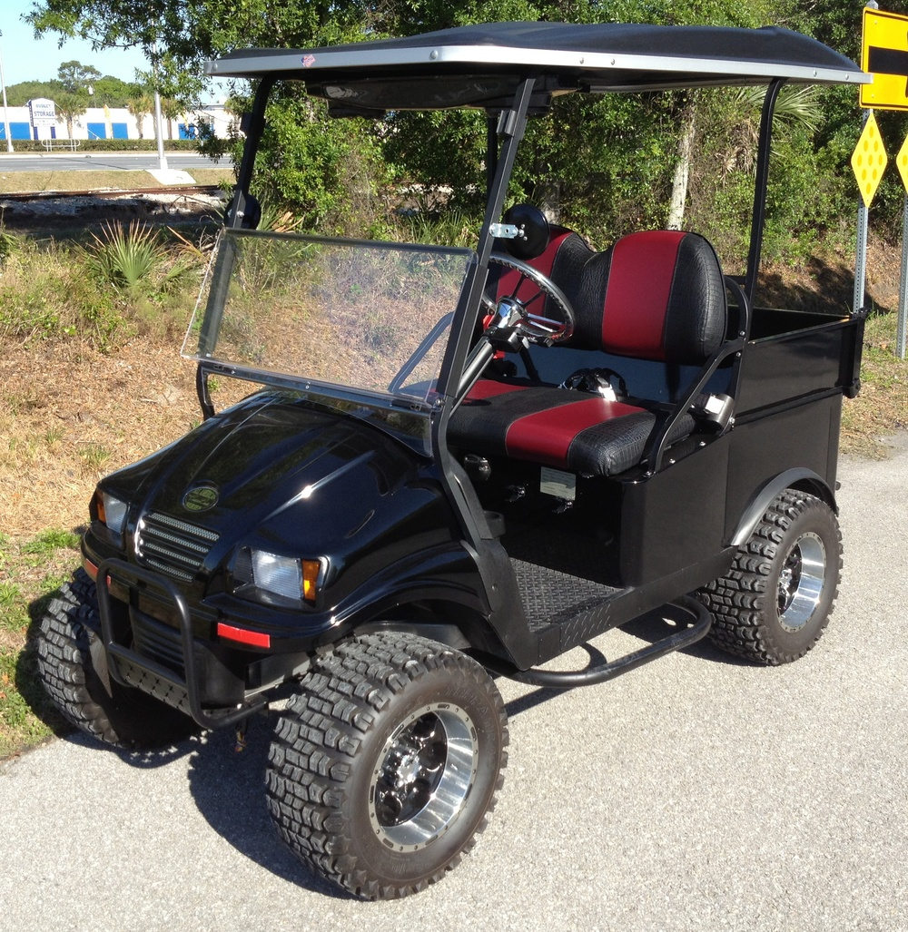 """Lifted"" UTV with custom two-tone seating and seat belts."