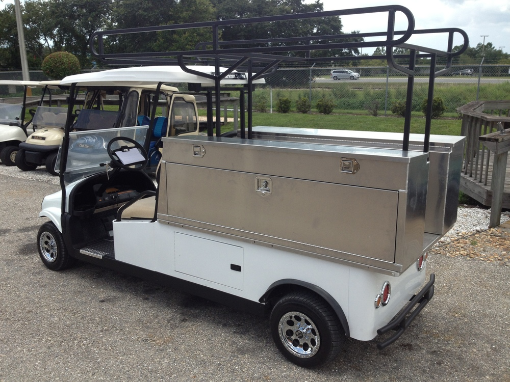 "2 passenger utility vehicle with a Reading Truck utility boxes. Boxes are 48"" L x 15″ W x 24″ H."