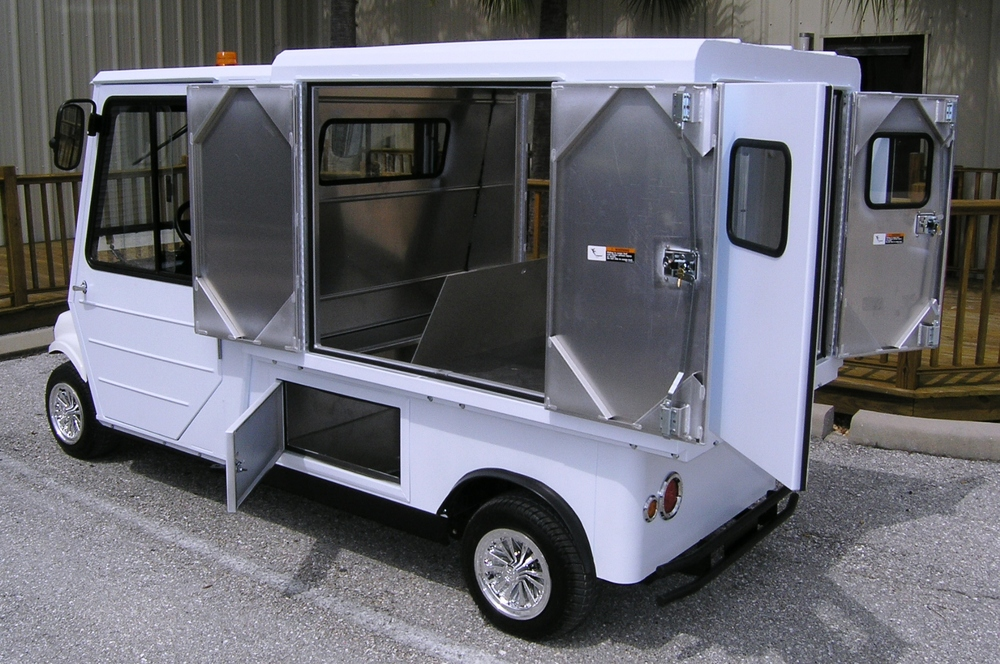 "2 passenger utility vehicle with cargo van 6'L x 26""W x 40"" H and rear and side locking doors."