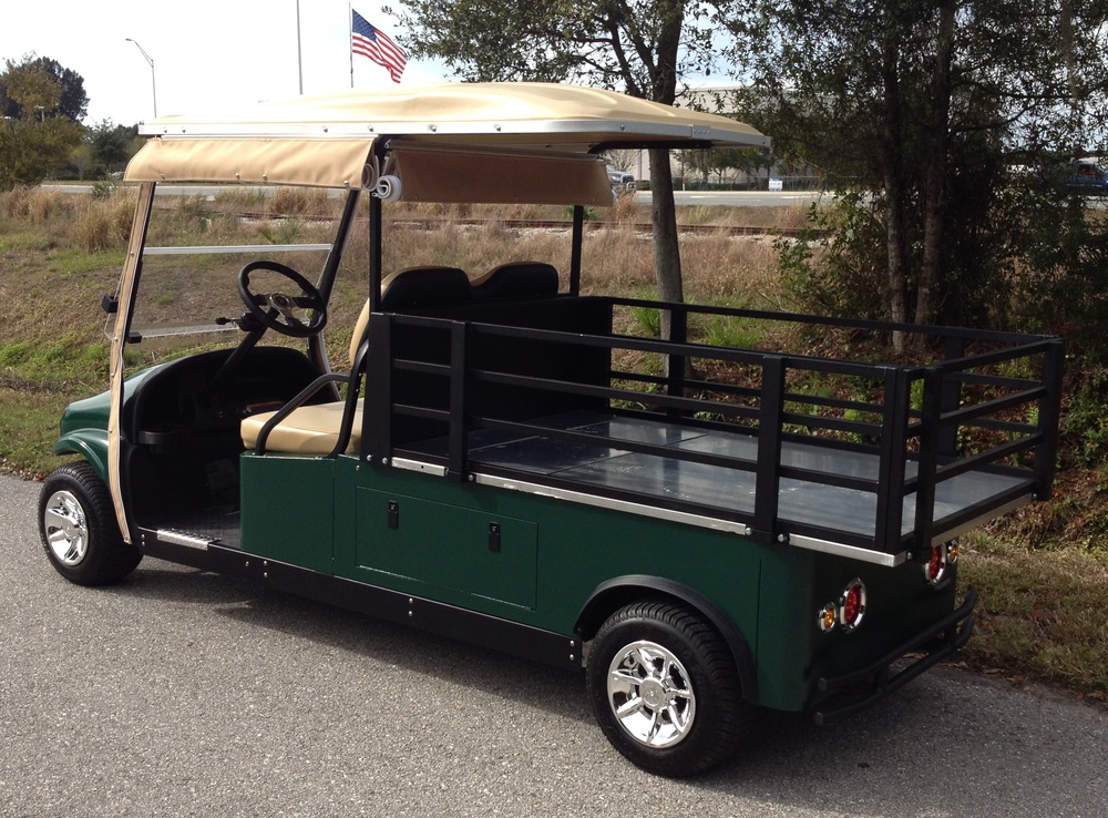 "2 passenger utility cart with a 48"" x 72″ x 10″ stake bed style cargo area."
