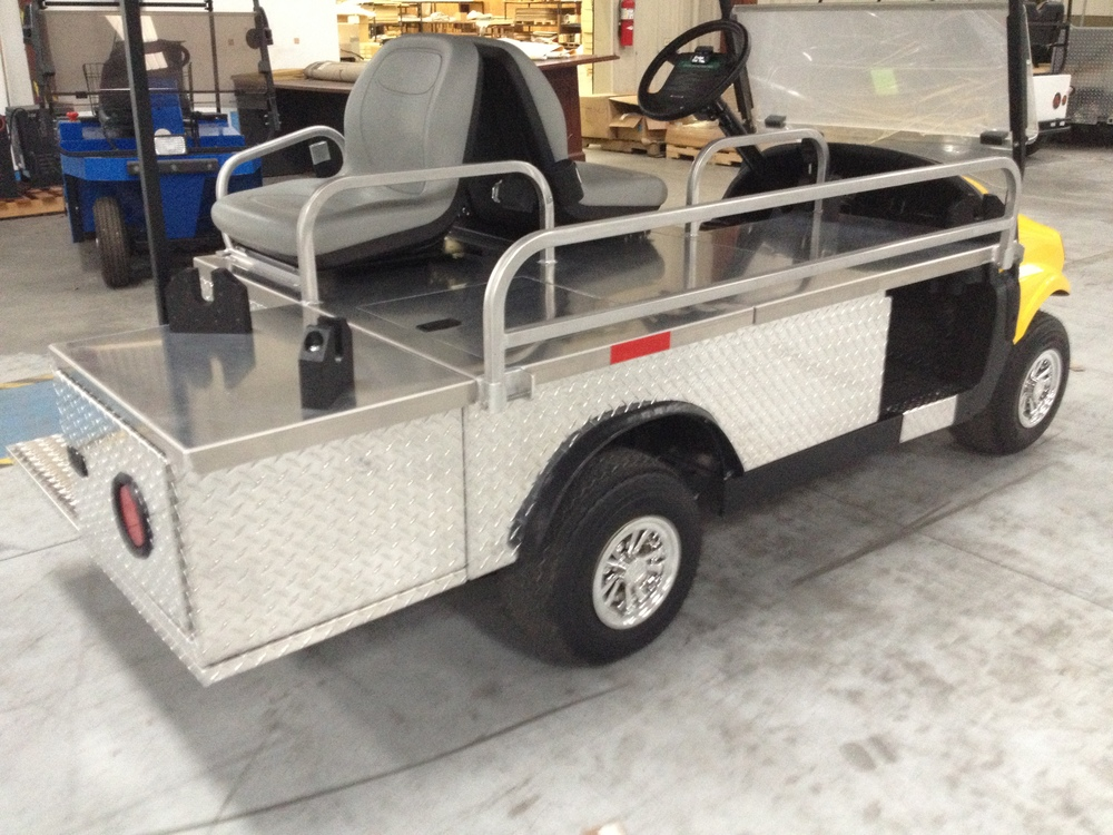 R2AMB: Ambulance golf cart vehicle – 2 passenger plus stretcher. Carries 1 Ferno #9 stretcher with extra storage. Available in electric, solar electric and gas.