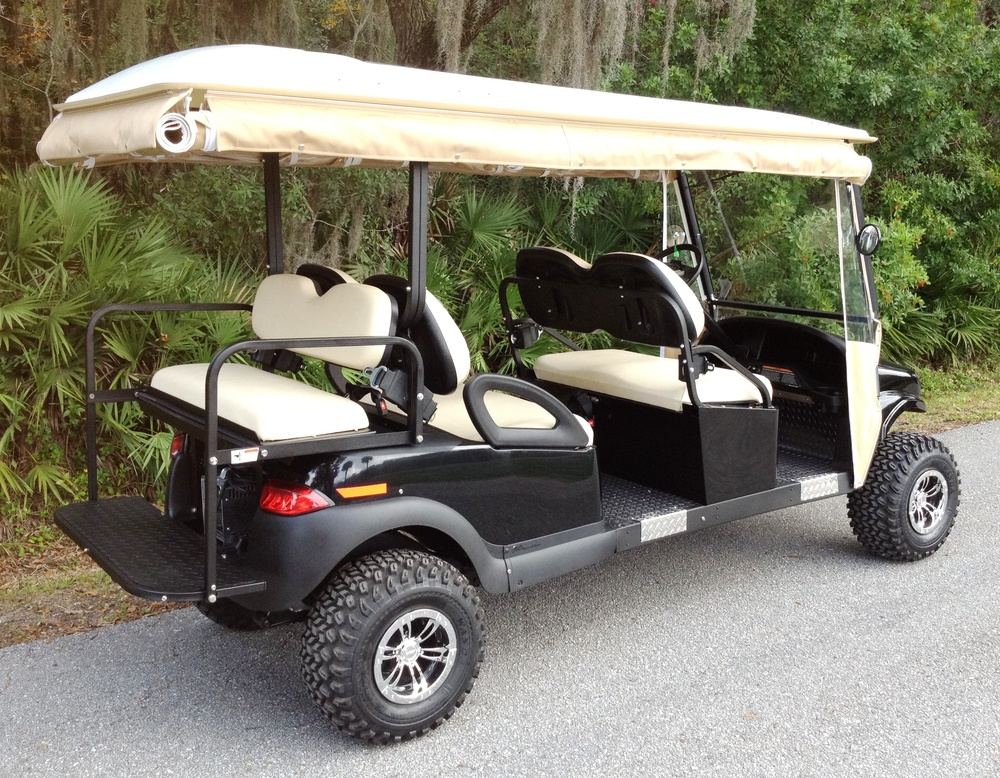 M6BTB: 4 forward-facing, 2 rear facing passenger transport, golf-cart-style vehicle with lift kit, custom tires, and adjustable sunbrella enclosure.