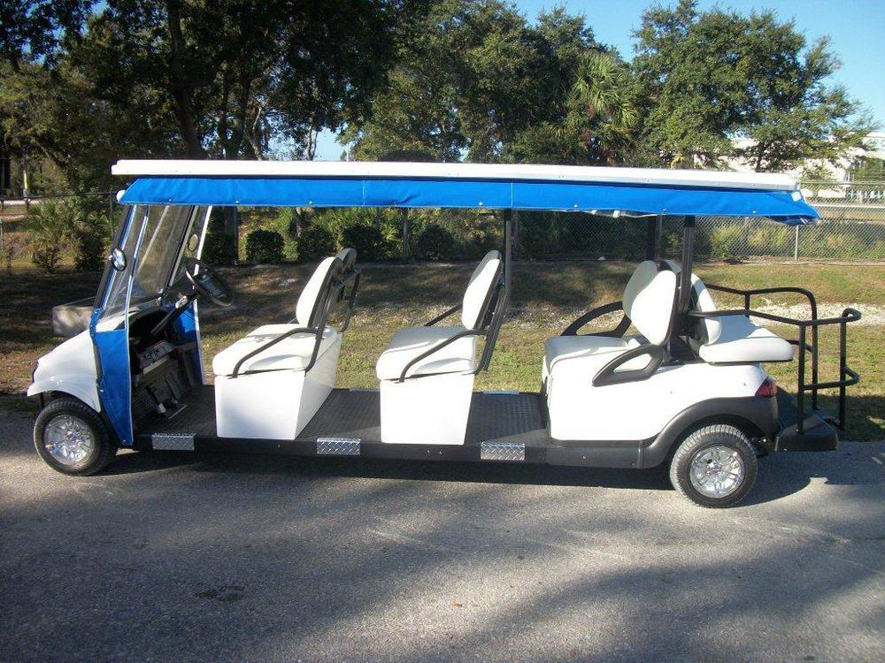 8 passenger back to back (6 forward and 2 back) transport golf cart style vehicle.