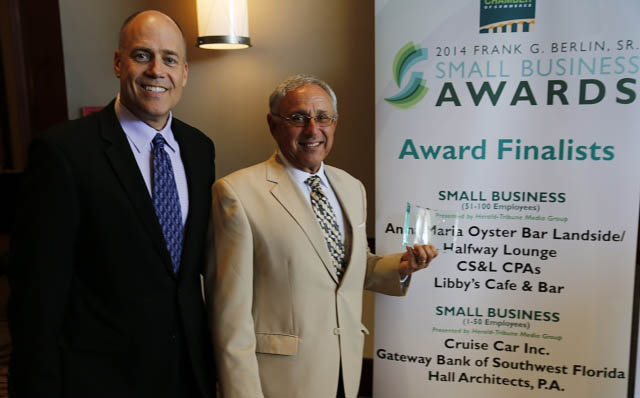 Adam and Ken accepting award at Small Business of the Year assembly at the Sarasota, FL Chamber of Commerce.