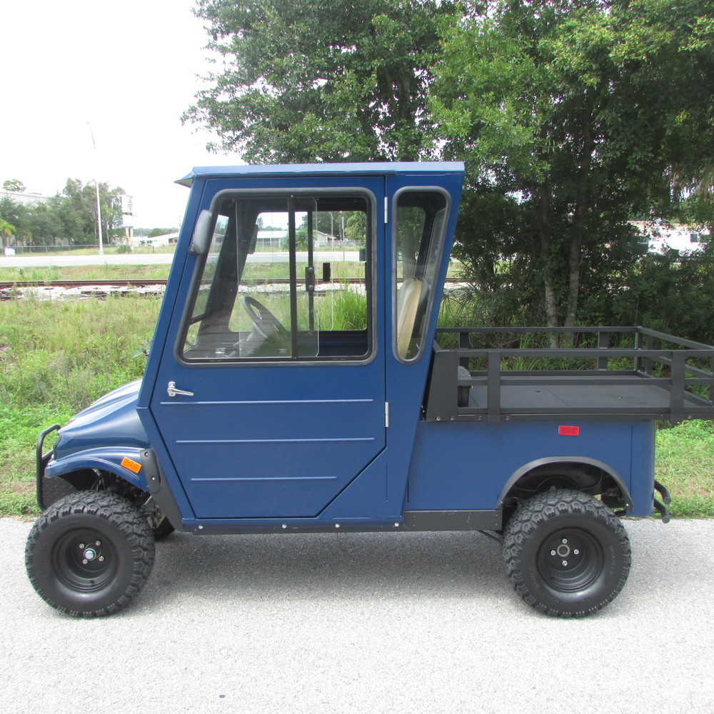 2 passenger utility vehicle with 4'x4' cargo bed and hard cab enclosure.
