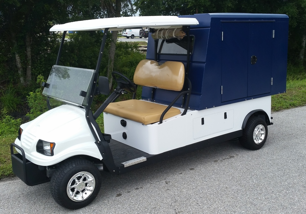 "2 passenger utility cart with rear cargo van 6'L x 26""W x 40"" H and rear and side locking doors"