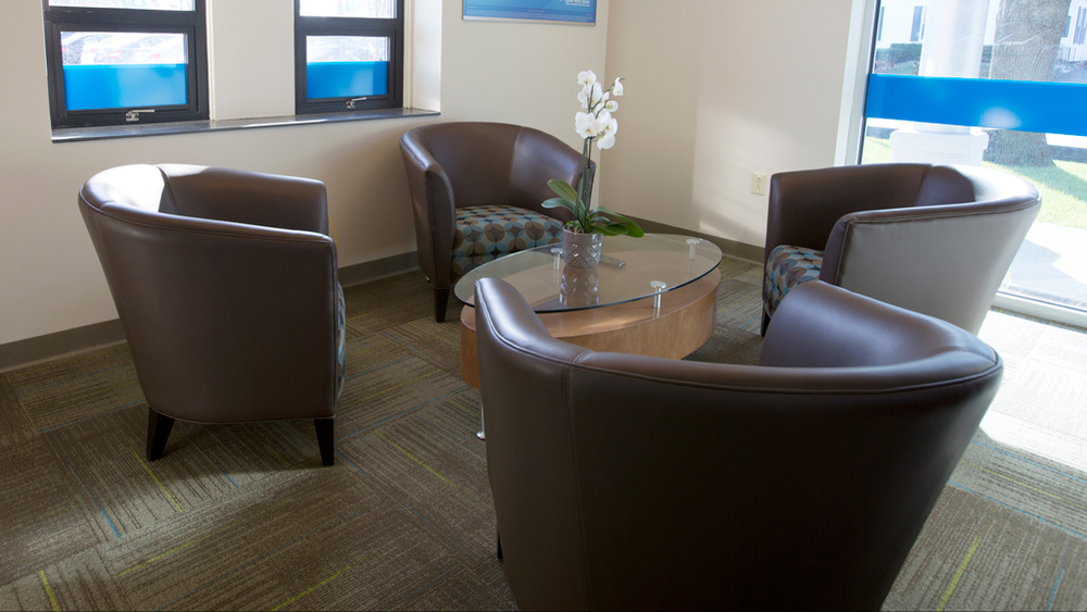 Interior view of conference room, materials and furniture specified by Caleigh Pollard.