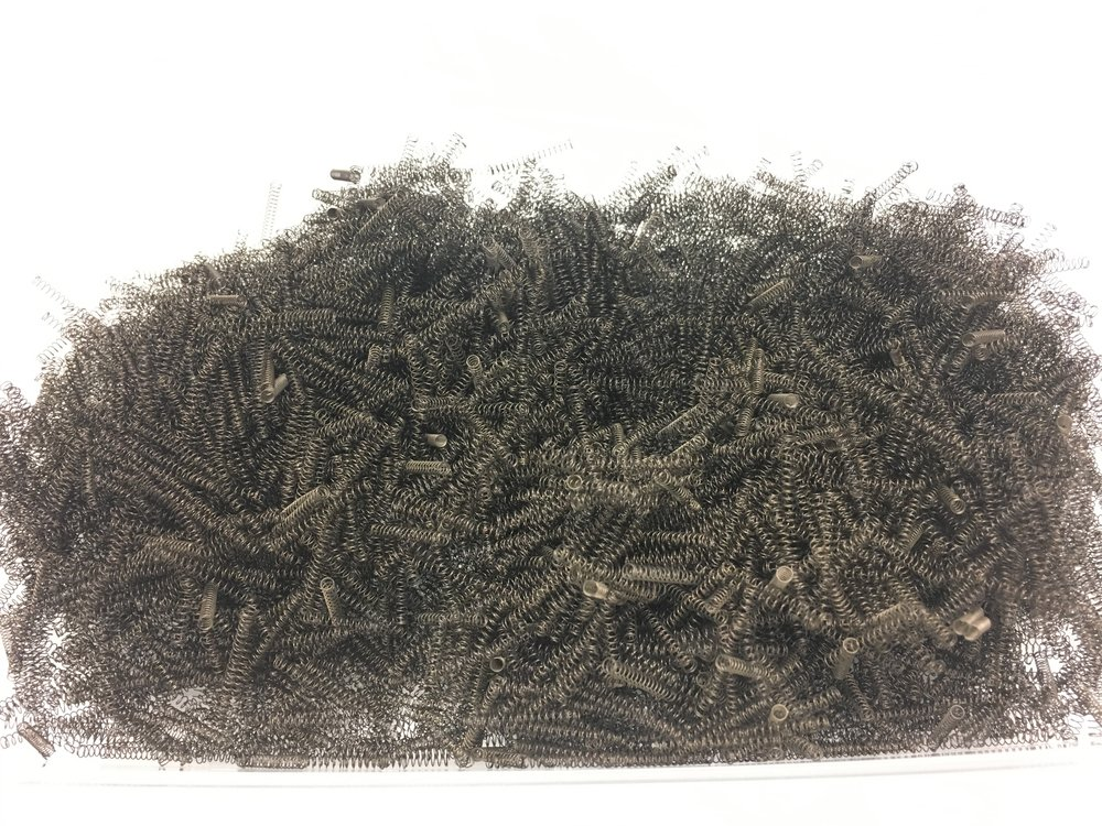 5000 springs doesn't look like much: This is all of them, together weighing less than a pound.