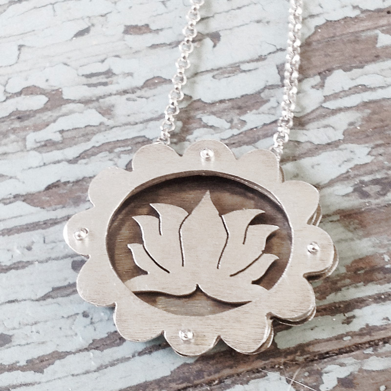 Large scalloped shadowbox necklace with lotus flower.