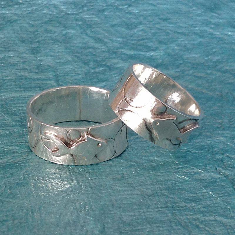 Matching sterling silver fish wedding bands.
