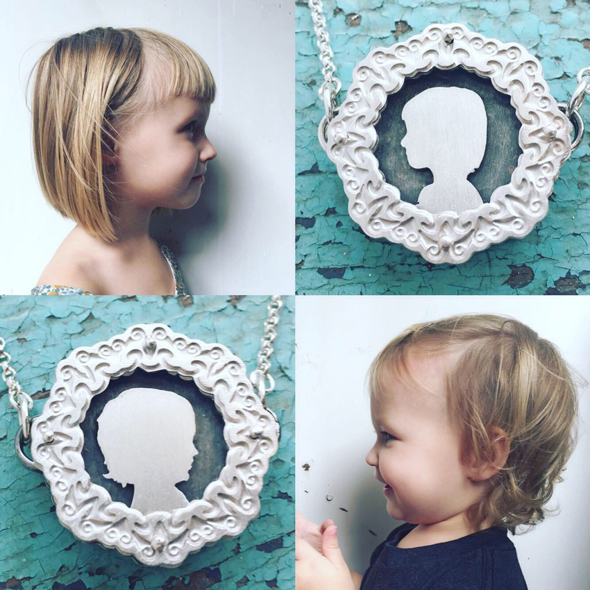 Five layer, two sided small etched shadowbox necklace featuring silhouettes of children.