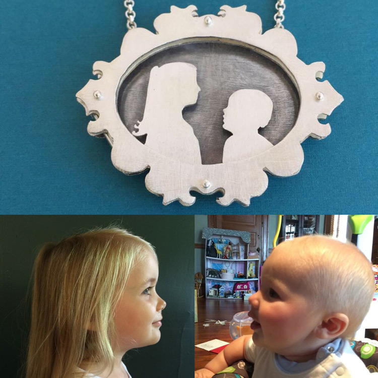 Ornate shadowbox necklace with silhouettes of children.